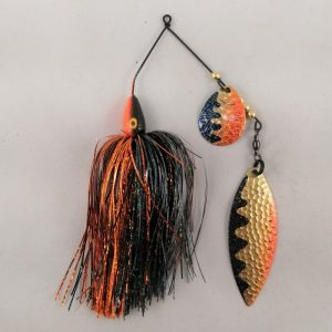 Black and orange spinnerbait with flash skirting