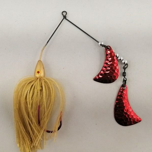 Gold spinnerbait with red hatchet blades