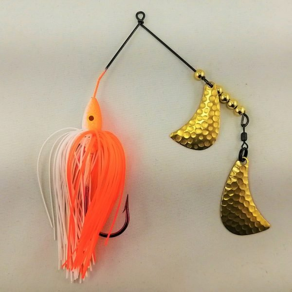 Orange and white spinnerbait with brass hatchet blades