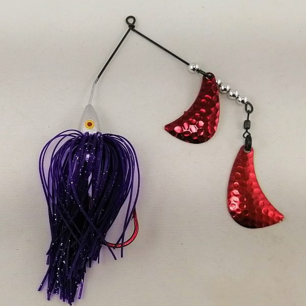 Silver and purple spinnerbait with red hatchet blades